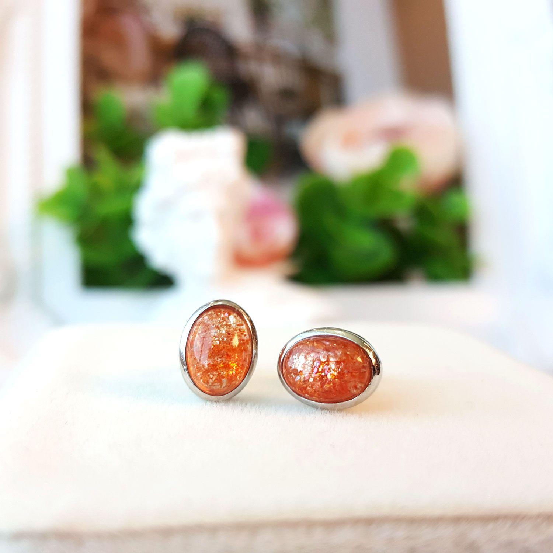 金草莓石椭圆形耳环